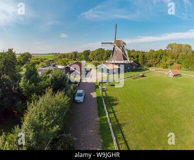 Saw mill called De Bolwerksmolen, Deventer,   Overijssel, , Netherlands, 30071264 *** Local Caption *** windmill, field, meadow, trees, summer, aerial - Stock Photo