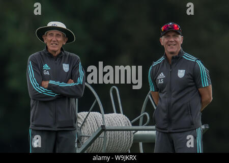 London, UK.13 August, 2019.  Surrey bowling Coach Geoff Arnold (left) with Alec Stewart , Director of Cricket watching the 2nd  XI taking on Somerset on day two of the 2nd XI County Championship South Group game at the LSE sports ground, New Malden. David Rowe/Alamy Live News - Stock Photo