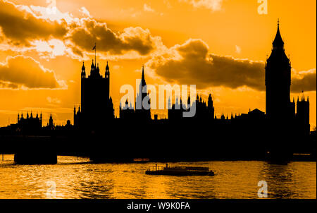 Silhouette of the Palace of Westminster / Houses of Parliament on the River Thames at sunset in Westminster, City of Westminster, London, England, UK. - Stock Photo