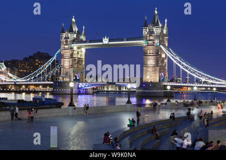 Tourists in front of City Hall, River Thames and Tower Bridge, London, England, United Kingdom, Europe Stock Photo