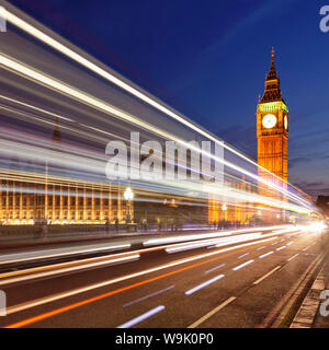 Motion blurred red double decker bus, Houses of Parliament, Big Ben, Westminster Bridge, London, England, United Kingdom, Europe - Stock Photo