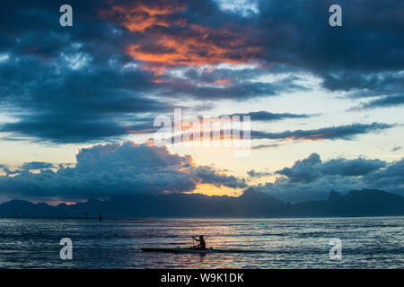 Dramatic sunset over Moorea, Papeete, Tahiti, Society Islands, French Polynesia, Pacific - Stock Photo