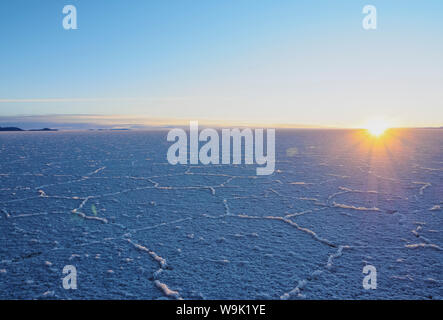 View of the Salar de Uyuni, the largest salt flat in the world, at sunrise, Daniel Campos Province, Potosi Department, Bolivia, South America - Stock Photo