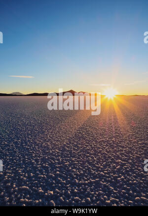 Sunset over the Salar de Uyuni, the largest salt flat in the world, Daniel Campos Province, Potosi Department, Bolivia, South America - Stock Photo