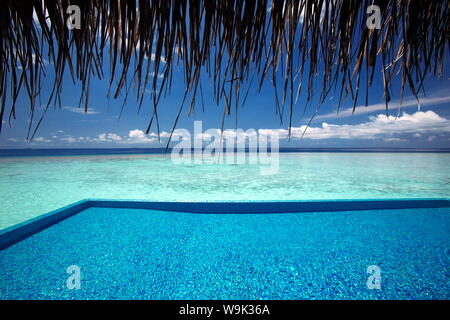 Infinity pool and lagoon, Maldives, Indian Ocean, Asia - Stock Photo