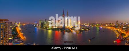 Pudong skyline across Huangpu River, including Oriental Pearl Tower, Shanghai World Financial Center and Shanghai Tower, Shanghai, China, Asia - Stock Photo