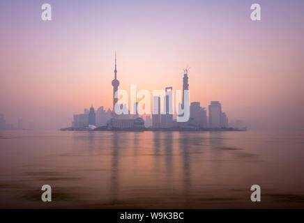 Pudong skyline across Huangpu River, including Oriental Pearl Tower, Shanghai World Financial Center, and Shanghai Tower, Shanghai, China, Asia - Stock Photo