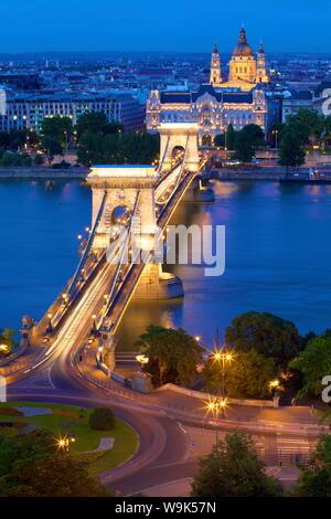 Chain Bridge, Four Seasons Hotel, Gresham Palace and St. Stephen's Basilica at dusk, UNESCO World Heritage Site, Budapest, Hungary, Europe - Stock Photo