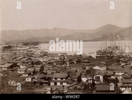 [ 1890s Japan - Japanese Harbor ] —   Panoramic view of Tsuruga Port (敦賀港) in Fukui Prefecture. An Imperial decree in July 1899 (Meiji 32) established Tsuruga as an open port (開港場) for trading with the United States and the United Kingdom. This served as an impetus for local industry.  19th century vintage albumen photograph. - Stock Photo