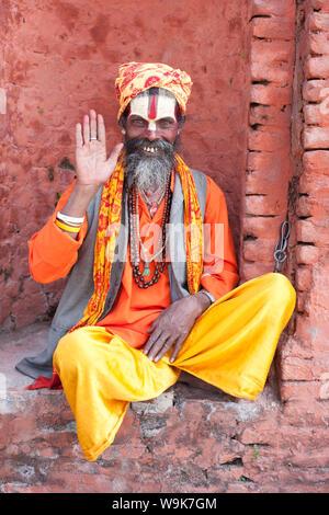 Sadhu (Holy Man) wearing brightly coloured clothing and characteristic facial painting at Pashupatinath Temple, Kathmandu, Nepal, Asia - Stock Photo
