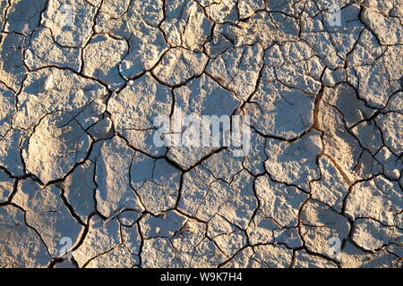 Dried mud/cracked earth at Sossusvlei in the ancient Namib Desert near Sesriem, Namib Naukluft Park, Namibia, Africa - Stock Photo