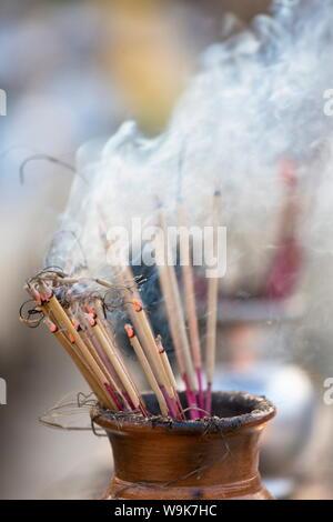 Incense burning at Shwedagon Paya (Pagoda), Yangon (Rangoon), Myanmar (Burma), Asia - Stock Photo