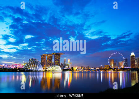 Gardens by the Bay, Cloud Forest, Flower Dome, Marina Bay Sands Hotel and Casino, and Singapore Flyer ferris wheel, Singapore, Southeast Asia, Asia - Stock Photo