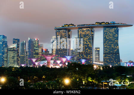 Gardens by the Bay, Supertree Grove and Marina Bay Sands Hotel and Casino, Singapore, Southeast Asia, Asia - Stock Photo