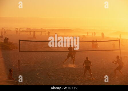 Beach volleyball game, late afternoon, Camps Bay, Cape Town, South Africa, Africa - Stock Photo