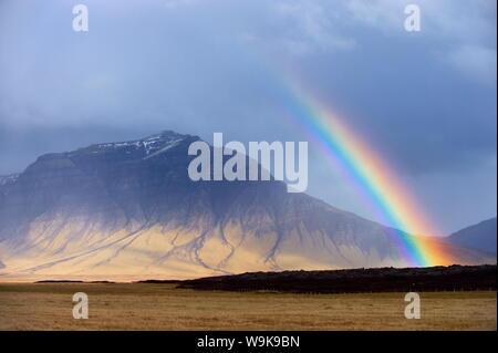 Rainbow over hills, Snaefellsnes Peninsula, West Iceland, Iceland, Polar Regions - Stock Photo