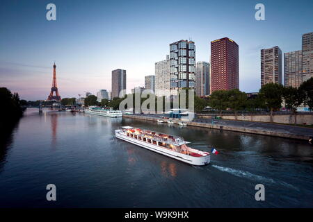 Night view of River Seine with high-rise buildings on the Left Bank and Eiffel Tower in the distance, Paris, France, Europe - Stock Photo