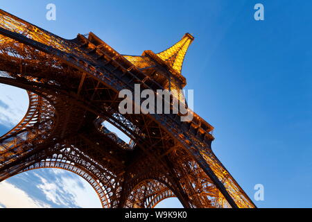 View upwards from underneath the Eiffel Tower in Paris, France, Europe