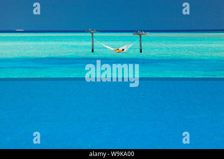 Infinity pool and hammock in lagoon, Maldives, Indian Ocean, Asia - Stock Photo