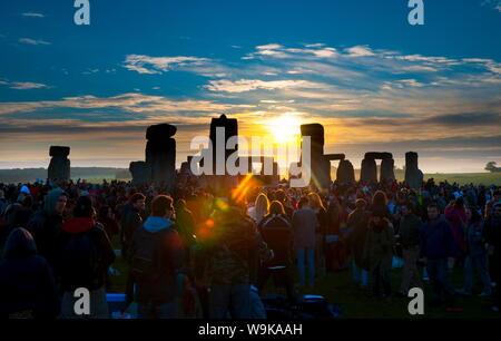 Sunrise at Summer Solstice celebrations, Stonehenge, UNESCO World Heritage Site, Wiltshire, England, United Kingdom, Europe - Stock Photo