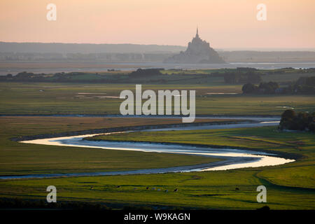 View over meandering river to Bay of Mont Saint-Michel, UNESCO World Heritage Site, from Jardin des Plantes viewpoint, Avranches, Normandy, France