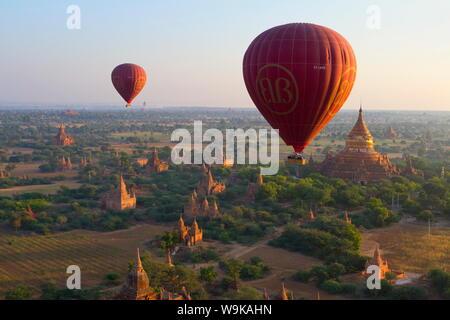 Dawn over ancient temples from hot air balloon, Bagan (Pagan), Central Myanmar, Myanmar (Burma), Asia - Stock Photo