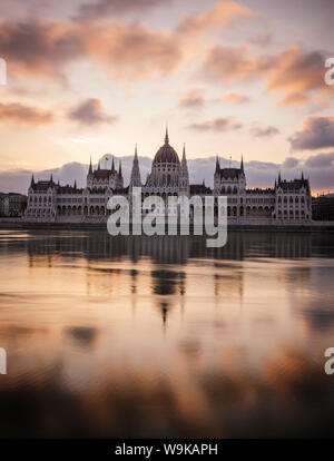 Sunrise behind the Hungarian Parliament Building and Danube River, Budapest, Hungary, Europe - Stock Photo