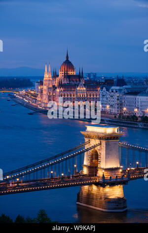 View over River Danube, Chain Bridge and Hungarian Parliament Building at night, UNESCO World Heritage Site, Budapest, Hungary, Europe - Stock Photo