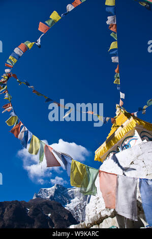 Prayer flags and Buddhist stupa, Namche Bazaar, Solu Khumbu Region, Nepal, Himalayas, Asia - Stock Photo