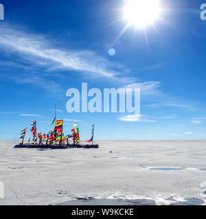 Colorful Flags From All Over the World at Uyuni Salt Flat, Bolivia, South America - Stock Photo