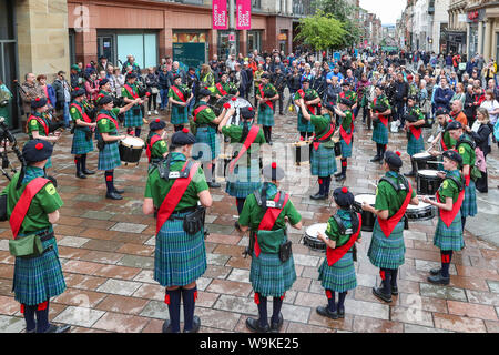 Glasgow, Scotland, UK. 14th Aug 2019. The 16th year of Glasgow's International Piping Festival continued with free concerts in Buchanan Street from an selection of Pipe Bands including Canadian and American enjoyed by 100's of spectators who were not put off by the heavy rain showers. Lord Selkirk RFM Pipe Band from Canada Credit: Findlay/Alamy Live News - Stock Photo