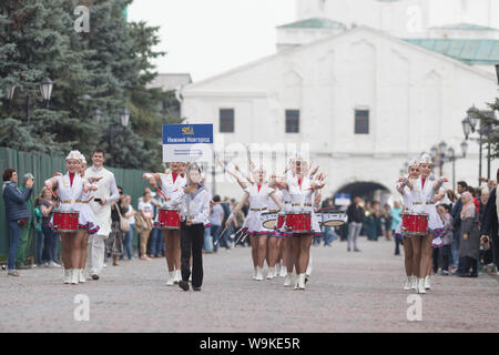 RUSSIA, KAZAN 09-08-2019: A wind instrument parade - women with bright make up in small skirts playing red drums - Nizhny Novgorod ensemble of - Stock Photo