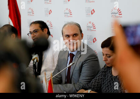 Tunis, Tunisia. 14th Aug, 2019. The head of Tunisia's Independent High Authority for elections (ISIE) Nabil Baffoun speaks during a press conference to announce the approved candidacies for the upcoming presidential election. Twenty-six candidacies to the Tunisian presidential election of September 15 have been validated and 71 rejected. Credit: Khaled Nasraoui/dpa/Alamy Live News - Stock Photo