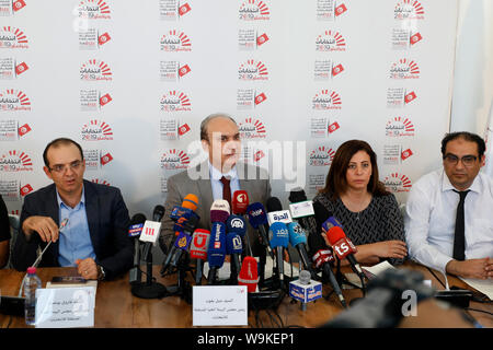 Tunis, Tunisia. 14th Aug, 2019. The head of Tunisia's Independent High Authority for elections (ISIE) Nabil Baffoun (C) speaks during a press conference to announce the approved candidacies for the upcoming presidential election. Twenty-six candidacies to the Tunisian presidential election of September 15 have been validated and 71 rejected. Credit: Khaled Nasraoui/dpa/Alamy Live News - Stock Photo