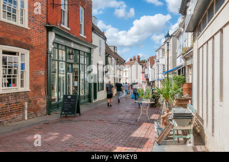 People walking down West Street in Faversham on a sunny summers day. - Stock Photo