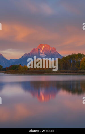 Mount Moran reflected in the still waters of Ox Bow Bend along the Snake River, Grand Teton National Park, Wyoming - Stock Photo