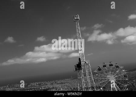 Panoramic view of Barcelona, photographed with an unusual perspective. Scenic view over the Tibidabo Amusement Park. Black and white image. - Stock Photo
