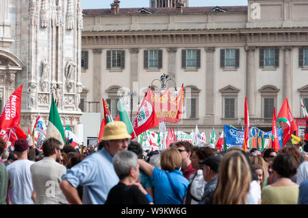 Milan, Italy - April 25 2013: Demonstration with flags in Piazza Duomo in Milan Stock Photo
