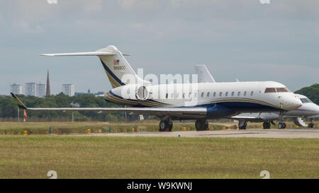 Glasgow, UK. 22 June 2019. The private jet of the pop star, Pink, who is in Glasgow today to perform at her concert later this evening at Hampden Stadium in Glasgow. Her private jet transport is seen parked up on the ramp at Glasgow International Airport.  The jet which is a Bombardier Global Express (reg N908CC) is one of the largest luxury private narrow body private jets around costing around US$70M. Credit: Colin Fisher/CDFIMAGES.COM - Stock Photo
