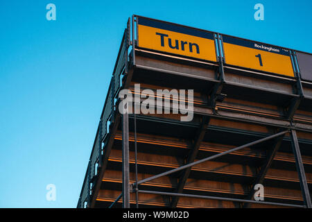 A view of the Turn 1 Grandstand at the closed Rockingham Motor Speedway in Corby, Northamptonshire - Stock Photo