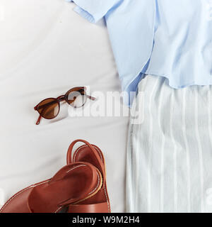 woman going to pack her clothes into the suitcase, luggage, top view cropped photo - Stock Photo