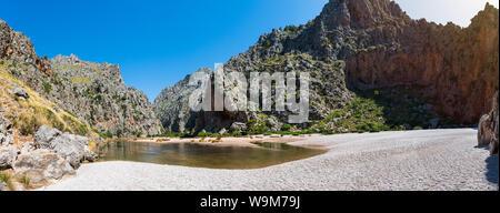 Beautiful summer panoramic landscape. River Torrent de Pareis between mountains. Wild beach in Sa Calobra, Palma de Mallorca, Spain. Popular tourist - Stock Photo