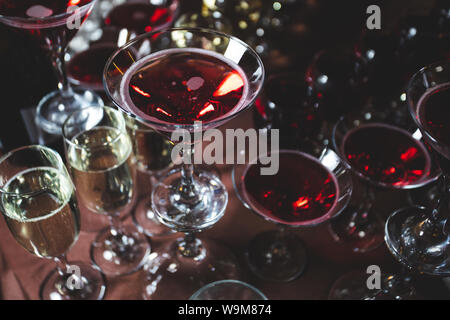Many glasses of alcoholic drinks, champagne and cocktails on the festive table - Stock Photo