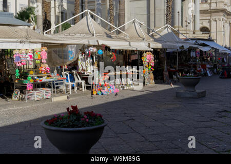 Pompei, Italy February 9 2018: Modern city outdoor church market. Street vendors selling mementos & souvenirs outside the Shrine of Our Lady of the Ro - Stock Photo