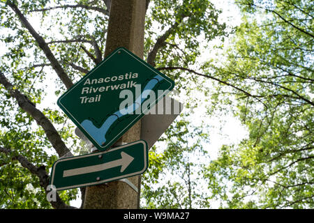 Washington, DC - August 7, 2019: Sign for the Anacostia Riverwalk Trail located along the waterfront of Southwest District of Columbia USA - Stock Photo