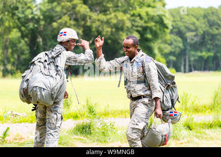 Soldiers congratulating each other at 2019 Leapfest, international static line parachute training event and competition, hosted by RI Natl. Guard. - Stock Photo