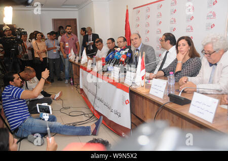 Tunis, Tunisia. 14th Aug, 2019. Nabil Baffoun (4th R), President of the Independent High Authority for Elections (ISIE), speaks at a press conference in Tunis, Tunisia, on Aug. 14, 2019. The Independent High Authority for Elections announced on Wednesday that 26 candidates had been approved for the early presidential elections scheduled for Sept. 15. Credit: Adele Ezzine/Xinhua - Stock Photo