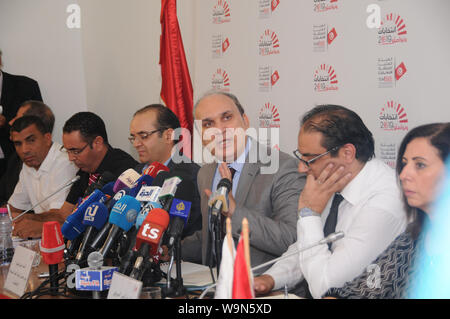 Tunis, Tunisia. 14th Aug, 2019. Nabil Baffoun (3rd R), President of the Independent High Authority for Elections (ISIE), speaks at a press conference in Tunis, Tunisia, on Aug. 14, 2019. The Independent High Authority for Elections announced on Wednesday that 26 candidates had been approved for the early presidential elections scheduled for Sept. 15. Credit: Adele Ezzine/Xinhua - Stock Photo