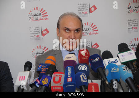 Tunis, Tunisia. 14th Aug, 2019. Nabil Baffoun, President of the Independent High Authority for Elections (ISIE), speaks at a press conference in Tunis, Tunisia, on Aug. 14, 2019. The Independent High Authority for Elections announced on Wednesday that 26 candidates had been approved for the early presidential elections scheduled for Sept. 15. Credit: Adele Ezzine/Xinhua - Stock Photo