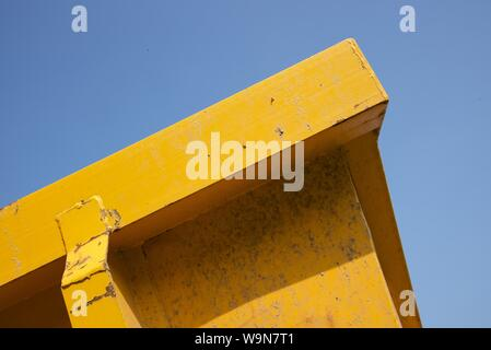 A close up of a steel fabricated low-loader container used for transporting bulk waste material in France - Stock Photo